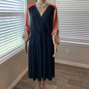 Authentic BCBGMAXAZRIA color block pleated dress.
